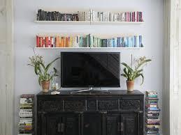 flat screen tv in living room designs. books arranged by color flat screen tv in living room designs o