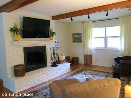 hanging television over fireplace mounting to brick fireplace hanging television above fireplace