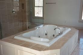 custom shower and tub deck stone installation
