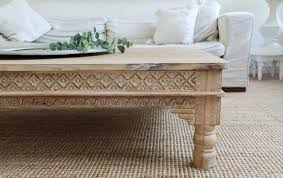 teak coffee table with handcarved accents