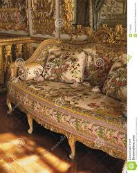 furniture in queen marie antoinette bedroom at versailles palace