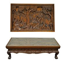 inset glass top deep relief carved vietnamese low table heavily carved throughout depicting elephants working