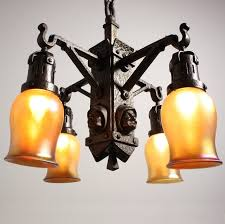 sold rare antique arts and crafts figural monks head four light chandelier c