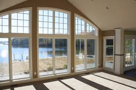 wall of patio doors with windows above the arch adds interest lancia custom built lake