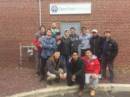 members of the pi lambda phi fraternity at the open door exchange open door exchange is a munity outreach program serving the suffolk county area