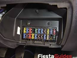 fiestaguides co uk > mk5 guides > electrical > remote central locking this will expose the screws that hold the box to the under side of the dash remove these screws and push the fuse box out