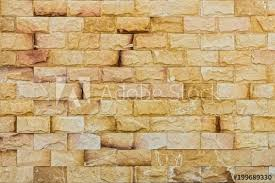 natural yellow rock fence the exterior decoration of many building
