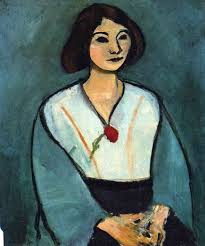 Woman in green with a carnation by Henri Matisse