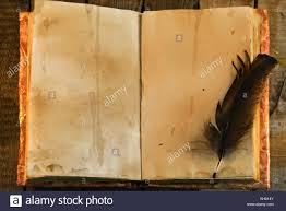 old book with shabby pages and black quill top view