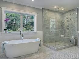 Contemporary Master Bathroom with Wyndham Collection Mermaid 5.92 ft.  Center Drain Soaking Tub, Rain shower, Wainscotting | bathrooms | Pinterest  | Rain ...