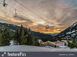 empty ski lift chairs at sunrise royalty free stock photo