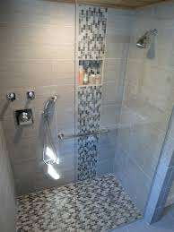 interior shower room with grey wall tile and stainless steel shower on the wall completed