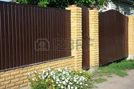 Us Door And Fence New Brick And Metal Fence With Door And Gate Photo