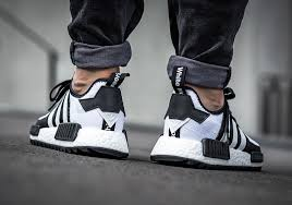 adidas nmd. nmd fans will also want to take not of another coveted upcoming release, the \u201ctriple black\u201d r1 with japanese details. adidas nmd
