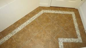 simple use flat pebble mosaic tile to create a border for your shower floor