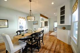 dining room entrancing decorating ideas using rectangular white fabric stacking chairs and oval black wooden