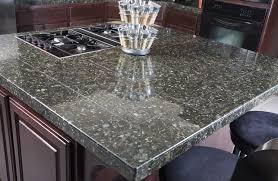 granite countertops and glass tile backsplash