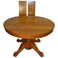 round oak 45 claw foot dining table with 2 leaves