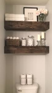 diy bathroom wall storage. want thinner shelves- floating shelves above the toilet in this bathroom is much prettier and more useful than pointless towel bar that was there. diy wall storage