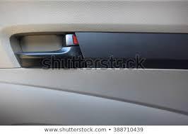 Inside car door handle Closeup Inside Car Door Handle And Automatic Lock Shutterstock Inside Car Door Handle Automatic Lock Stock Photo edit Now