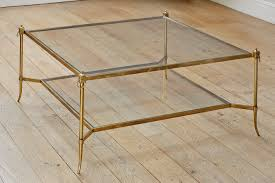 A Square Patinated Brass And Glass Coffee Table. ...