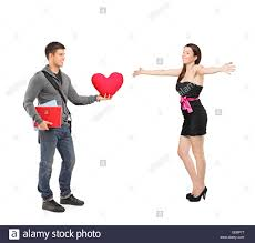 Man Shaped Pillow Boy Holding A Red Heart Shaped Pillow In His Hand And An Excited