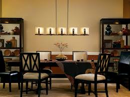elegant furniture and lighting. Elegant Dining Room Design With Linear Chandelier And Parson Chairs Plus Dark Wood Table On Furniture Lighting