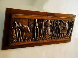 wooden wall hanging fish panel