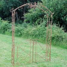 scrolled rustic rose arch with gates