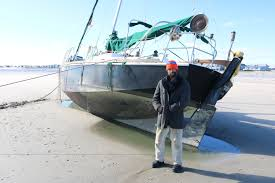Beached Boat Leaves Sailor High And Dry In Sea Isle Sea