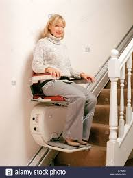 standing stair lift. Woman Using Stairlift - Stock Image Standing Stair Lift