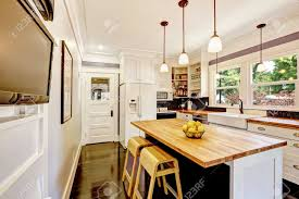 kitchens with white appliances. Stock Photo - White Kitchen Cabinet With Appliances. Island Wooden Counter Top And Stools Kitchens Appliances
