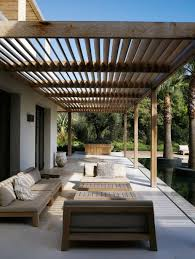 Modern Pergolas Backyard Long Paio With Wooden Furniture And Sunspot At The