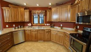 staggered kitchen wall cabinets with crown moulding 2