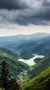 Green mountains, lake, village, clouds ...