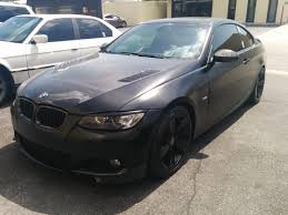 custom flat black paint job accenting carbon fiber features on bmw painted and customized by b b auto