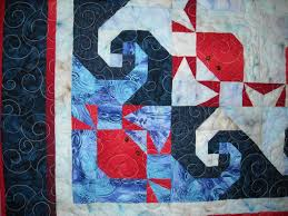 Sid's In Stitches: Quilt Shows Are Fun! & Slowly But Surely They Followed Us by Kitty Sager I love the stylized crabs  in this quilt combined with the Monkey Wrench block which looks like waves. Adamdwight.com