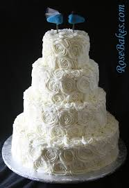 Ivory Buttercream Roses Wedding Cake With Lovebirds Cake Topper