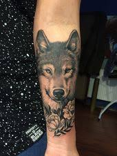 Realistic <b>wolf</b> and <b>peony</b> tattoo on a woman lower arm. Beautiful ...