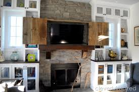 brand new barn door tv cabinet above mantle cleverly inspired cm48