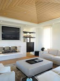 example of a coastal living room design in los angeles with white walls a two