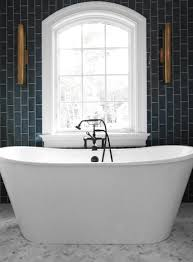 oil rubbed bronze freestanding tub filler. bathroom with gray vertical subway tiles oil rubbed bronze freestanding tub filler h