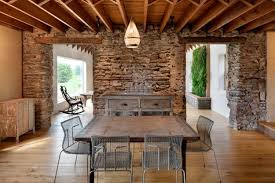 Rustic Wood Furniture, Antique Stone Wall And Exposed Ceiling Beams