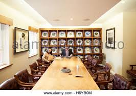 office space memorabilia. manchester oxford court pfa office boardroom football caps framed used large table memorabilia space interior t