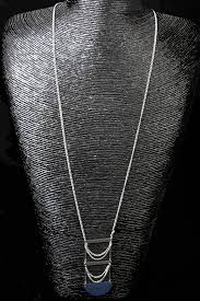 long simple silver necklace with blue pendant