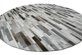 round gray cowhide patchwork rug in stripes design