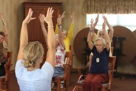 chair yoga for seniors. jessie friskney teaches a chair yoga class at rosegate. for seniors