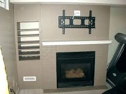 tv over gas fireplace hanging over fireplace hang above fireplace mount above fireplace into brick install