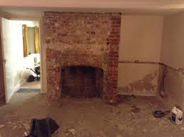 the next job was cleaning it i was desperate to keep the old exposed brick but it didn t look too great all covered in mortar and dust and we weren t