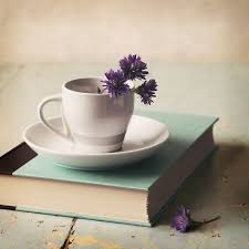 still life photography book and teacup flowers